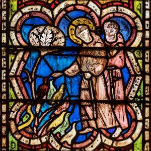 Basilica Superiore, navata: la vetrata della prima campata.